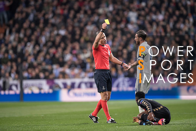 Sergio Ramos of Real Madrid gets a yellow card during the match Real Madrid vs Napoli, part of the 2016-17 UEFA Champions League Round of 16 at the Santiago Bernabeu Stadium on 15 February 2017 in Madrid, Spain. Photo by Diego Gonzalez Souto / Power Sport Images