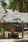 Xingu River, Para State, Brazil. Ilha da Fazenda settlement. A well and traditional housing.