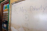The dry erase board at Edward Hynes Elementary and Middle School in the city of New Orleans shows the last date class was held, on December 10, 2005.