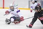 Sochi, RUSSIA - Mar 9 2014 -  A Norway player takes a shot during Canada vs. Norway at the 2014 Paralympic Winter Games in Sochi, Russia.  (Photo: Matthew Murnaghan/Canadian Paralympic Committee)