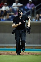 Home plate umpire Jacob McConnell hustles to get into position during a game between the Lynchburg Hillcats and the Kannapolis Cannon Ballers at Atrium Health Ballpark on August 28, 2021 in Kannapolis, North Carolina. (Brian Westerholt/Four Seam Images)