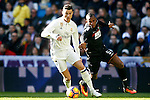 Real Madrid's Cristiano Ronaldo (l) and Granada CF's Uche Agbo during La Liga match. January 7,2016. (ALTERPHOTOS/Acero)