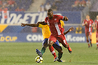 Harrison, NJ - Friday July 07, 2017: Loic Baal, David Junior Hoilett during a 2017 CONCACAF Gold Cup Group A match between the men's national teams of French Guiana (GUF) and Canada (CAN) at Red Bull Arena.
