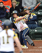 Michigan Wolverines during the shortstop Sierra Romero (32) hits a grand slam home run during the teams season opener against the Florida Gators on February 8, 2014 at the USF Softball Stadium in Tampa, Florida.  Florida defeated Michigan 9-4 in extra innings.  (Mike Janes/Four Seam Images via AP Images)