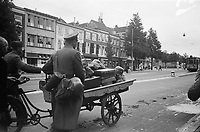 Photo from the NIOD's Huizinga collection. German soldiers flee on Dolle Tuesday with a cargo bike full of belongings via the Spui to the railway terminus near Rijnstraat.