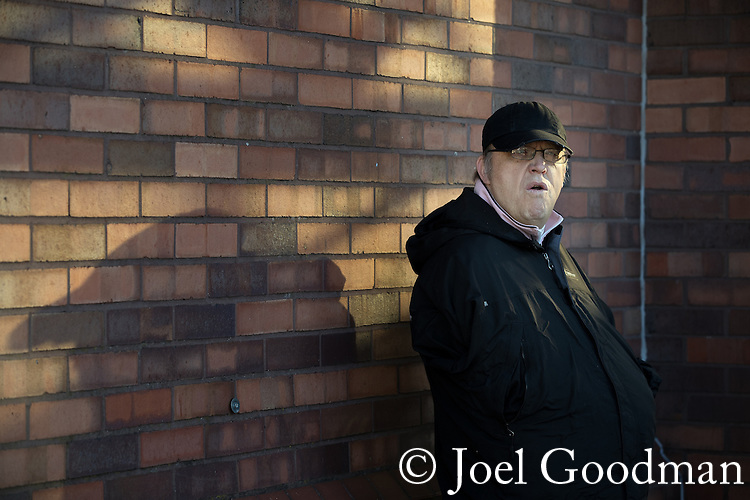 "© Joel Goodman - 07973 332324 . 26/11/2016 . Bolton , UK . Police detain a man outside Bolton Station . Approximately 100 people attend a demonstration against the construction of mosques in Bolton , under the banner "" No More Mosques "" , organised by a coalition of far-right organisations and approximately 150 anti fascists opposing the demonstration , in Victoria Square in Bolton Town Centre . Photo credit : Joel Goodman"