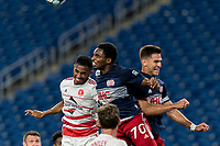 FOXBOROUGH, MA - AUGUST 21: Ivan Magalhaes #4 of Richmond Kickers and Jon Bell #70 of New England Revolution II battle for head ball during a game between Richmond Kickers and New England Revolution II at Gillette Stadium on August 21, 2020 in Foxborough, Massachusetts.