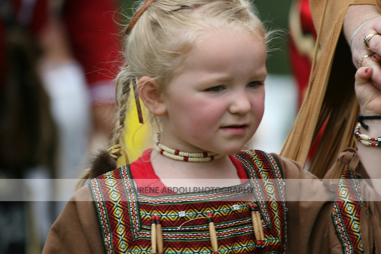 An American Indian girl wears a traditional dress at the 8th Annual Red Wing American Indian PowWow at Red Wing Park in Virginia Beach, Virginia.
