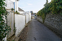 Pictured: The narrow lane leading to the slipway where the Mini car with Kiara Moore entered river Teifi from in Cardigan, west Wales, UK. Tuesday 20 March 2018<br /> Re: The funeral of two year old Kiara Moore, who died after being recovered from a silver Mini car found in river Teifi in Cardigan will be held today (Tue 27 Mar 2018) at Parc Gwyn Crematorium, Narberth, west Wales.<br /> Kiara was taken at the University Hospital of Wales in Cardiff after being rescued but was pronounced dead.<br /> It is believed the car she was in, rolled down a slipway while her mother got out momentarily to get cash out of the family business premises.<br /> Her parents Jet Moore and Kim Rowlands have expressed their grief on social media.
