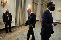 United States President Joe Biden departs after making remarks on the state of vaccinations in the State Dining Room of the White House in Washington, DC on Tuesday, April 6, 2021. Earlier, the President said he expects a significant portion of the population to be vaccinated by the end of the summer. <br /> CAP/MPI/RS<br /> ©RS/MPI/Capital Pictures