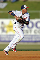 Tennessee Smokies shortstop Javier Baez #9 fields and throws to first during a game against the Mobile BayBears at Smokies Park on August 25, 2013 in Kodak, Tennessee. The BayBears won the game 2-0. (Tony Farlow/Four Seam Images)