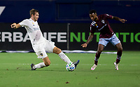 CARSON, CA - SEPTEMBER 19: Nicholas DePuy #20 of the Los Angeles Galaxy and Kellyn Acosta #10 of the Colorado Rapids battle for a ball during a game between Colorado Rapids and Los Angeles Galaxy at Dignity Heath Sports Park on September 19, 2020 in Carson, California.