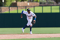 Glendale Desert Dogs shortstop Errol Robinson (3), of the Los Angeles Dodgers organization, throws to first base during an Arizona Fall League game against the Scottsdale Scorpions at Camelback Ranch on October 16, 2018 in Glendale, Arizona. Scottsdale defeated Glendale 6-1. (Zachary Lucy/Four Seam Images)