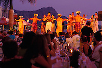 Polynesian revue at the Royal Hawaiian Hotel luau, with Diamond Head in the background
