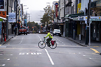A cyclist crosses the intersection of Cuba Street and Abel Smith Street at 10.15am on Wednesday during quarantine lockdown for COVID19 pandemic in Wellington, New Zealand on Wednesday, 1 April 2020. Photo: Dave Lintott / lintottphoto.co.nz