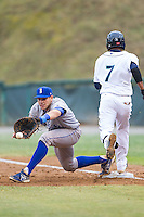 Brandon Dulin (26) of the Burlington Royals stretches for a throw as Gianfranco Wawoe (7) hustles down the first base line at Calfee Park on June 20, 2014 in Pulaski, Virginia.  The Mariners defeated the Royals 6-4. (Brian Westerholt/Four Seam Images)