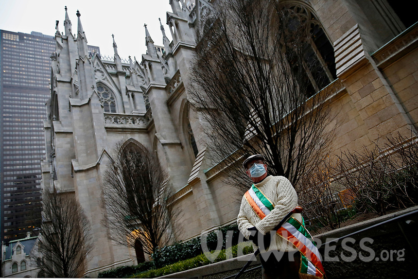 NEW YORK, NEW YORK - MARCH 17: A man waits during St. Patrick's Day parade on March 17, 2021 in New York. St. Patrick's Day Parade organizers say they postpone the celebration, but a small group marched to preserve the tradition. (Photo by John Smith/VIEWpress)