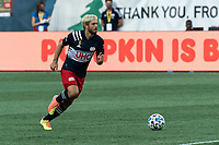 FOXBOROUGH, MA - SEPTEMBER 23: Kelyn Rowe #11 of New England Revolution dribbles at midfield during a game between Montreal Impact and New England Revolution at Gillette Stadium on September 23, 2020 in Foxborough, Massachusetts.