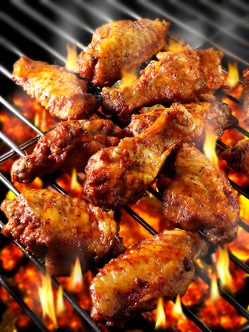 BBQ chicken wings being cooked on a bbq grill. Funky Stock library chicken wings images of bbq food.