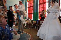 Groom and Best Man and the Bride during party games at the wedding reception in Kamchatka.