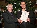 John Grant receives his Long Service Award from Ian Scott, Chair, Falkirk Community Trust.