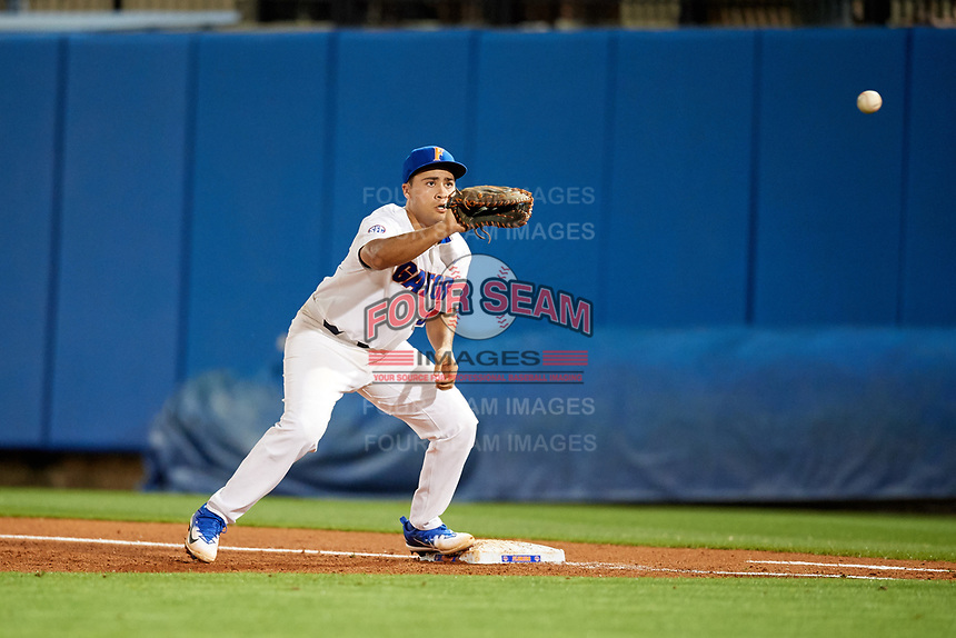 Florida Gators first baseman Keenan Bell (32) waits for a throw during a game against the Siena Saints on February 16, 2018 at Alfred A. McKethan Stadium in Gainesville, Florida.  Florida defeated Siena 7-1.  (Mike Janes/Four Seam Images)