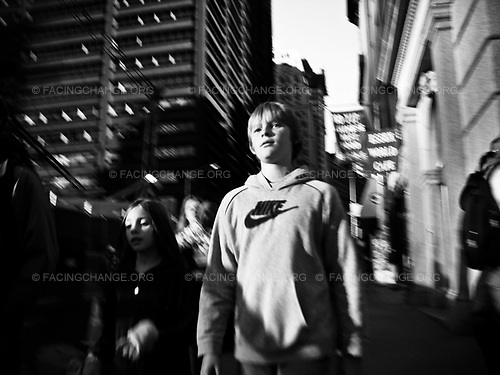 New York, New York<br /> USA<br /> October 2008<br /> <br /> A boy walking on the street for New York.