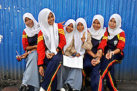 Muslim schoolgirls in headscarves opposite Ambon City's main Mosque. The 1999-2002 religious war between Maluku's Christian and Muslim populations, mainly centred on Ambon Island, led to over 5000 deaths and to around 500,000 people become displaced. Destroyed homes and offices, churches and mosques are slowly being either torn-down or renovated.  Urban centres, such as Ambon City, continue to be split along largely sectarian lines, and tensions are never far below the surface. Riots between Christian and Muslim youths erupted in September 2011 and, most recently, June 2012, though luckily simmered down just as quickly, partly due to community leaders learning how to defuse tensions from the earlier, more devastating, conflagration. /Felix Features