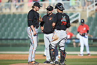 Delmarva Shorebirds pitching coach Justin Ramsey (center) has a meeting on the mound with relief pitcher Tyler Joyner (29) and catcher Daniel Fajardo (14) during the game against the Kannapolis Intimidators at Kannapolis Intimidators Stadium on May 19, 2019 in Kannapolis, North Carolina. The Shorebirds defeated the Intimidators 9-3. (Brian Westerholt/Four Seam Images)