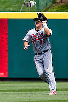 Mike Trout (23) of the Arkansas Travelers catches a fly ball during a game against the Springfield Cardinals on May 10, 2011 at Hammons Field in Springfield, Missouri.  Photo By David Welker/Four Seam Images.