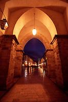 Illuminated Gateway into Luza Square and the the Stradun, Placa, Dubrovnik Old City, Croatia.