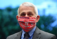 Director of the National Institute for Allergy and Infectious Diseases Dr. Anthony Fauci wears a Washington Nationals face mask when he arrives to testify before the House Committee on Energy and Commerce on the Trump Administration's Response to the COVID-19 Pandemic, on Capitol Hill in Washington, DC on Tuesday, June 23, 2020.    <br /> Credit: Kevin Dietsch / Pool via CNP/AdMedia