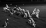 Bethel Park PA:  Offensive play with Mike Stewart 11 throwing a flat pass to Chip Huggins 32. Good blocks by Jim Dingeldine 73 and Clark Miller 30. Tom Skladany 86 played flanker on this play. Others in the photo; Don Troup 51, Gary Biro 81, Glenn Eisaman, Joe Barrett 75, Dennis Franks 66. The offense and defense did not play well in the 12-6 defeat vs Montour. Montour's quarterback, Bill Daniels, killed the Blackhawks.  Bill Daniels was played his college ball at Pitt.  The defensive unit was one of the best in Bethel Park history only allowing a little over 7 points a game.