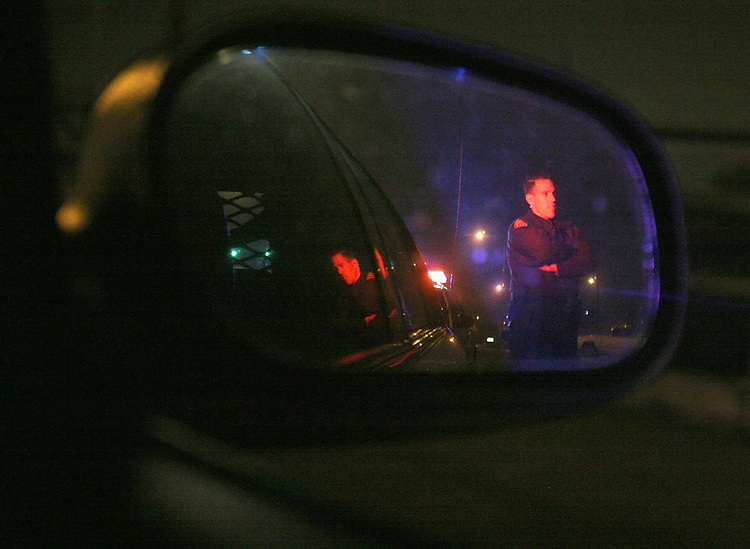 Beaverton Police officer Michael Smith talks with a Tigard Police officer during a traffic stop in Garden Home.<br /> Photo by Jaime Valdez