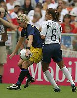 Victoria Svensson, left, Brandi Chastain, right, 2003 WWC USA Sweden.