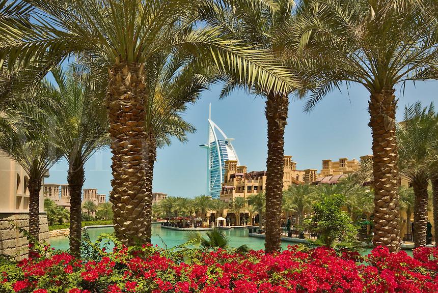 Madinat Jumeirah and Burj al Arab Hotel seen from the gardens of the Al Qasr Hotel. Dubai. United Arab Emirates.
