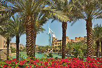 Madinat Jumeirah and Burj al Arab Hotel seen from the gardens of the Al Qasr Hotel. Dubai. United Arab Emirates.