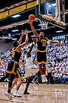 16 March 2019: UMBC Retriever Forward Arkel Lamar, a Junior from Bridgeport, CT, defends his net during second half play against the University of Vermont Catamounts, in the America East Championship Game at Patrick Gymnasium in Burlington, Vermont. The Catamounts defeated the Retrievers 66-49 to take the AE Championship for the 2018/2019 NCAA Men's Basketball season. Mandatory Credit: Ed Wolfstein Photo *** RAW (NEF) Image File Available ***