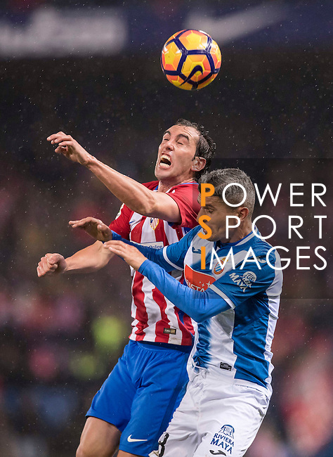 """Diego Roberto Godin Leal (l) of Atletico de Madrid fights for the ball with Savador Sevilla Lopez """"Salva S"""" of RCD Espanyol during the La Liga match between Atletico de Madrid and RCD Espanyol at the Vicente Calderón Stadium on 03 November 2016 in Madrid, Spain. Photo by Diego Gonzalez Souto / Power Sport Images"""
