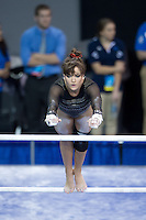 LOS ANGELES, CA - April 19, 2013:  Stanford's Rebecca Wing competes on bars during the NCAA Championships at UCLA.