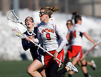 Laura Merrifield (9)  of Maryland sprints upfield with Molly Early (15) of Richmond closes in at the practice turf field in College Park, Maryland.  Maryland defeated Richmond, 17-7.