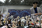 "May 3, 2010 - Tokyo, Japan - A visitor take pictures of PVC Figurines on display during the Treasure Festa 2010 at Tokyo Big Sight, Japan, on May 4, 2010. Some visitors and hobbyists concentrate specifically on a certain type of figure, such as garage kits, gashapon, or PVC bishojo (pretty girl) statues. According to many who study the phenomenon, many 'figure moe zoku', a Japanese term which refers to ""Otaku who collect figurines"", have difficulty in navigating modern romantic life and prefer to go on ""dates"" with their favorite figurine during off hours."
