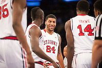 NEW YORK, NY - Sunday December 21, 2015: Ron Mvouika (#24) of St. John's and his team are frustrated as they trail Seton Hall at the half as the two teams square off in regular season play at Madison Square Garden.