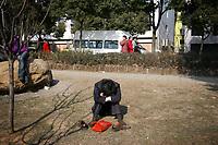 CHINA. Jiangxi Province.  Jiujiang. A man sitting in a park. Jiujiang is a city of 4.6 million people, located on the southern shore of the Yangtze River. 2008