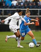 Stanford forward Lindsay Taylor (17) and North Carolina defender Amber Brooks (22) fight for control of the ball. North Carolina defeated Stanford 1-0 to win the 2009 NCAA Women's College Cup at the Aggie Soccer Stadium in College Station, TX on December 6, 2009.