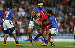 Glasgow 2014 Commonwealth Games<br /> Afa Alono and Levi Asifaamatala combine to stop James Davies.<br /> Wales v Samoa<br /> Ibrox Stadium<br /> <br /> 26.07.14<br /> ©Steve Pope-SPORTINGWALES