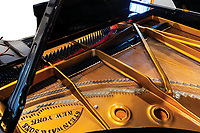 BNPS.co.uk (01202) 558833. <br /> Pic: HeritageAuctions/BNPS<br /> <br /> Sir Elton John's prized piano which he performed over 1,000 concerts on including John Lennon's final live show has sold for £664,000 following a bidding war. ($915,000)<br /> <br /> The flamboyant superstar had the black Steinway model transported with him wherever he took to the stage between 1972 and 1993.<br /> <br /> It was in situ for his 1974 Madison Square Garden concert when Lennon showed up for a bet and performed three songs, including 'Whatever Gets You Thru the Night'.<br /> <br /> The piano was also used by Queen frontman Freddie Mercury for their 1977 'Day at The Races' tour and Sir Paul McCartney when he played 'Let It Be' at Live Aid in 1985.<br /> <br /> It was sold by a sound engineer with Heritage Auctions, of Dallas, Texas, to fund his divorce.