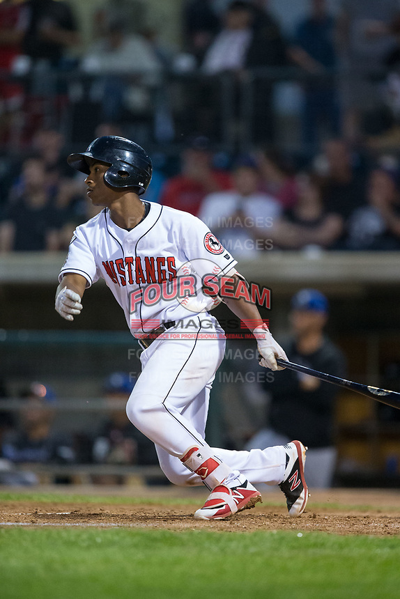 Jeter Downs (17) of the Billings Mustangs follows through on his swing against the Missoula Osprey at Dehler Park on August 21, 2017 in Billings, Montana.  The Osprey defeated the Mustangs 10-4.  (Brian Westerholt/Four Seam Images)