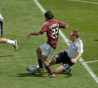 Bryan Namoff (white) tackles Nick LaBrocca in the penalty box. The Colorado Rapids defeated D.C. United 2-0. Dick's Sporting Goods Park, Denver, Colorado. May 4, 2008.