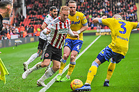 Leeds United's defender Barry Douglas (3) stops Sheffield United's midfielder Mark Duffy (21) during the Sky Bet Championship match between Sheff United and Leeds United at Bramall Lane, Sheffield, England on 1 December 2018. Photo by Stephen Buckley / PRiME Media Images.